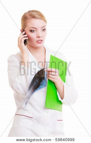 Young Woman Doctor Talking By Phone Isolated. Medicine.