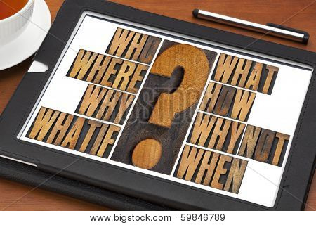 brainstorming or decision making concept - who, what, where, when, why, how, whatif and why not questions - a collage of words in vintage letterpress wood type on a digital tablet