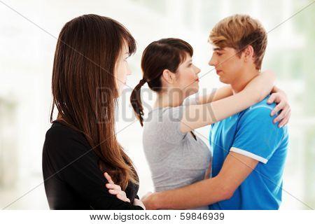 Sad brunette girl jealousy about her friends