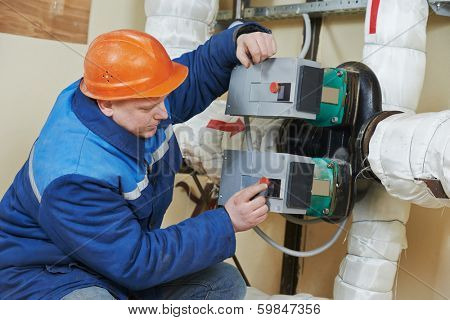 repairman engineer of fire engineering system or heating system open the valve equipment in a boiler house