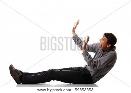 Scared young businessman, isolated on white