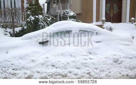 Car completely under snow after massive winter storms strikes Northeast