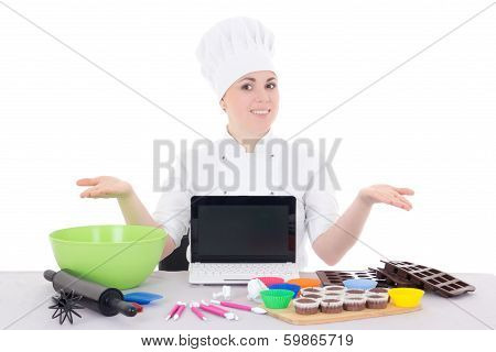 Female Confectioner In Cook Uniform Sitting At The Kitchen With Laptop With Copyspace Isolated On Wh