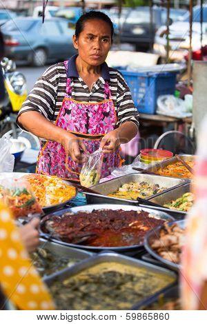 AYUTTHAYA, THAILAND - MAR 11: An unidentified street seller near Ayutthaya Historical Park on Mar 11, 2012 in Ayutthaya, Thailand.