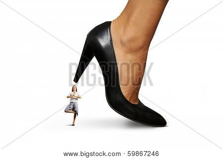 calm yoga businesswoman under big heel. isolated on white background