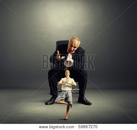 enraged boss screaming small female in dark empty room