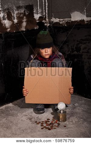 Poor Beggar Child On The Street With Blank Sign