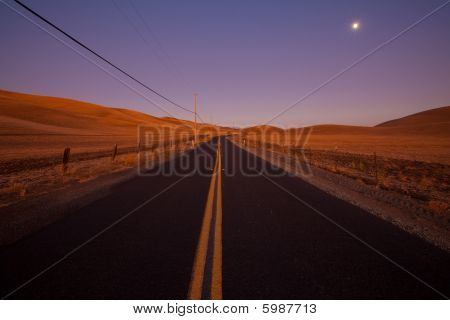 Romantic country road at dawn