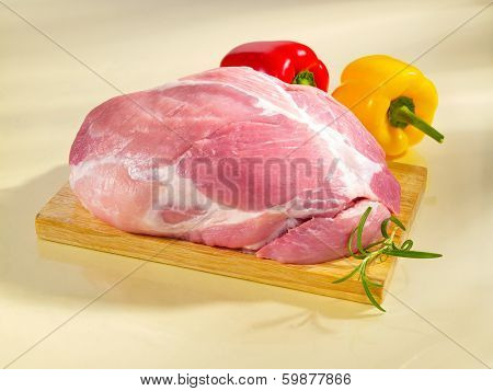 Raw Boneless Shoulder Square Cut On A Cutting Board.