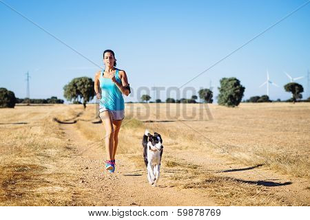 Woman Running Cross Trail In Countryside Path