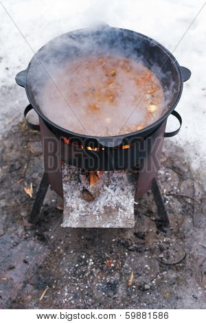 Food Stewed In Cauldron On Mobile Brazier