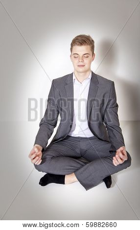 Young Businessman Posing, Meditating.