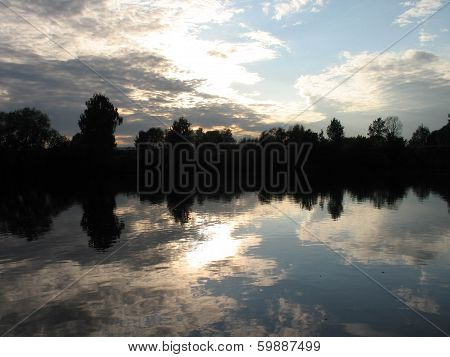 Sunset Clouds Reflected In A River