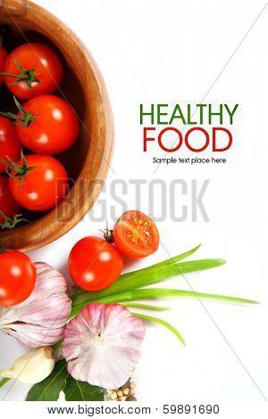 Cherry tomatoes and garlic on white background.