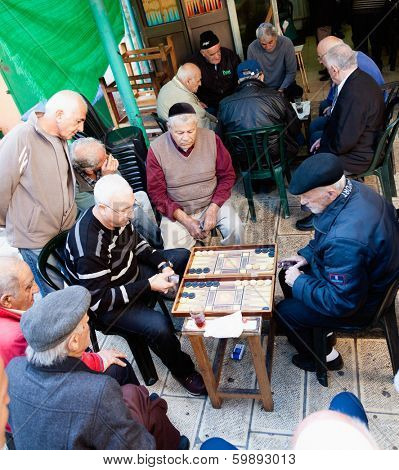Jerusalem, Israel - November 15, 2012: Men play backgammon game in a back alley of Mahane Yehuda, famous Jerusalem market