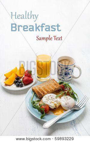Healthy breakfast : Poached Eggs, Wholegrain Bread, Orange Juice, Fruit and Vegetables