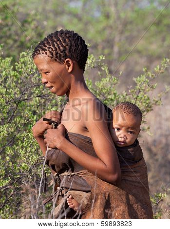 Portrate of Bushman woman with child in Botswana