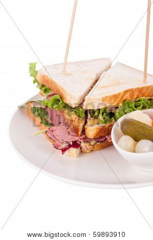 Delicious Pastrami Club Sandwich And Pickles