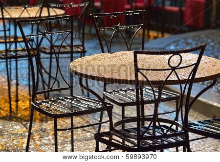 Tables At An Outdoor Cafe In The Rain