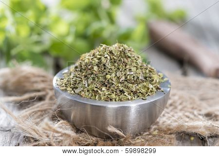 Bowl With Oregano On Wood