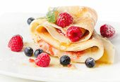 stock photo of crepes  - Crepes with berries and mint isolated on white - JPG