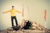 Man Traveler With Hands Raised On Mountain Summit Traveling Mountaineering And Freedom Concept Fog O