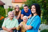 picture of kindness  - Confident and kind doctor welcoming the family members of the elderly patient - JPG