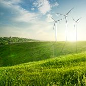 foto of generator  - Wind generators turbines on sunset summer landscape - JPG