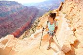 stock photo of pole  - Hiker woman hiking in Grand Canyon walking with hiking poles - JPG