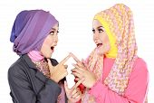 pic of muslimah  - Portrait of two beautiful moslem woman having fun together isolated over white background - JPG