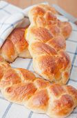foto of home-made bread  - Home made sweet braided bread on a wooden board - JPG