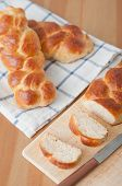 stock photo of home-made bread  - Home made sweet braided bread on a wooden board - JPG
