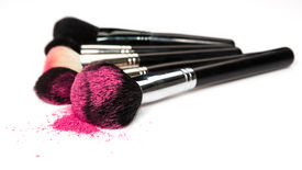 image of face-powder  - Makeup brushes and cosmetic powder on a white background - JPG