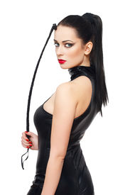 stock photo of latex woman  - Sexy woman in latex catsuit and whip isolated on white background - JPG