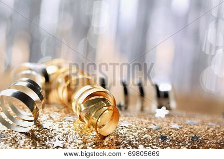 Gold paper ribbon on festive background