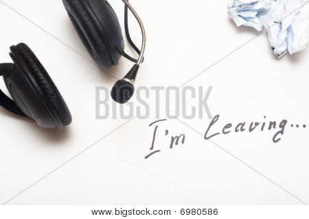 Ear-phones And Note With The Letter Of Resignation