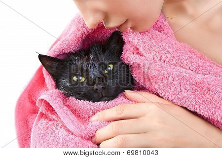 Woman Holding Cute Black Soggy Cat After A Bath