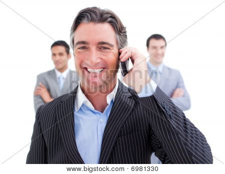 Laughing Businessman Talking On Phone