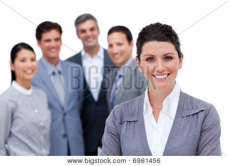 Happy Businesswoman With Folded Arms Standing With His Team