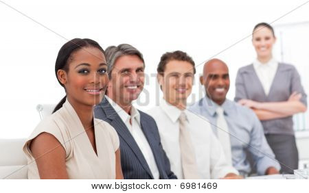Positive Business Team Smiling At The Camera