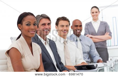 Multi-ethnic Business Team Smiling At The Camera