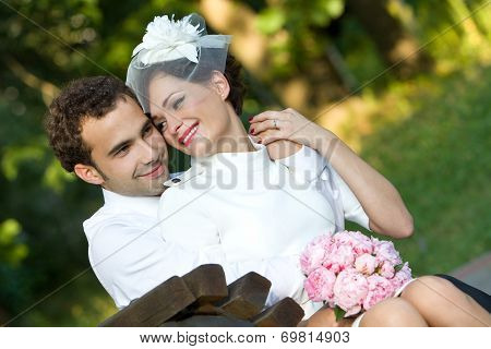 Wedding. Bride and groom with a bouquet of flowers.