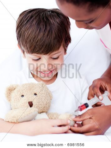 Attentive Female Doctor Playing With A Little Boy