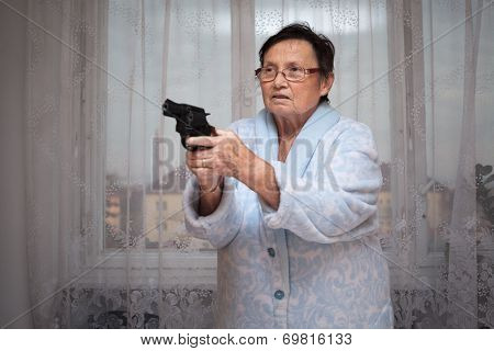 Senior Woman With A Gun