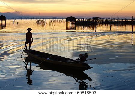 sunset and fisherman
