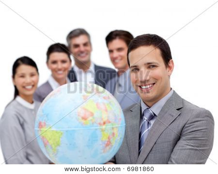 Victorious Business Team Holding A Terrestrial Globe