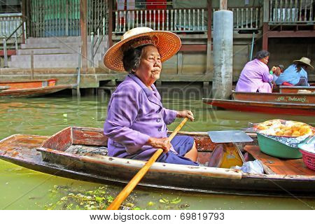 Unidentified Woman Is Sails In The Floating Market