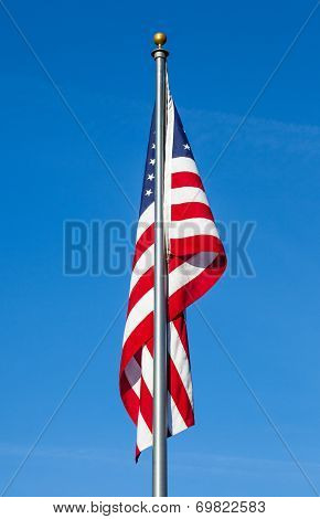 American Flag On Clear Blue Sky Background
