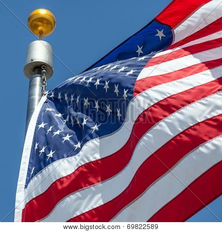 American Flag Blows In The Wind With Flag Pole