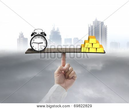 Clock And Gold Balancing On Seesaw Supported By Finger
